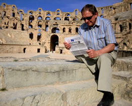 Al reading the OAPT Newsletter at the 3rd century Roman amphitheatre in El-Jem, Tunisia, in 2007