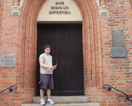 Sean in front of the birthplace of Nicolaus Copernicus, Torun, Poland, 19 February 1473